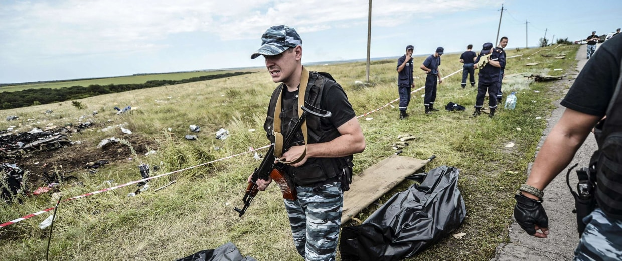 Image: Armed pro-Russian separatists block the way to the crash site of Malaysia Airlines Flight MH17
