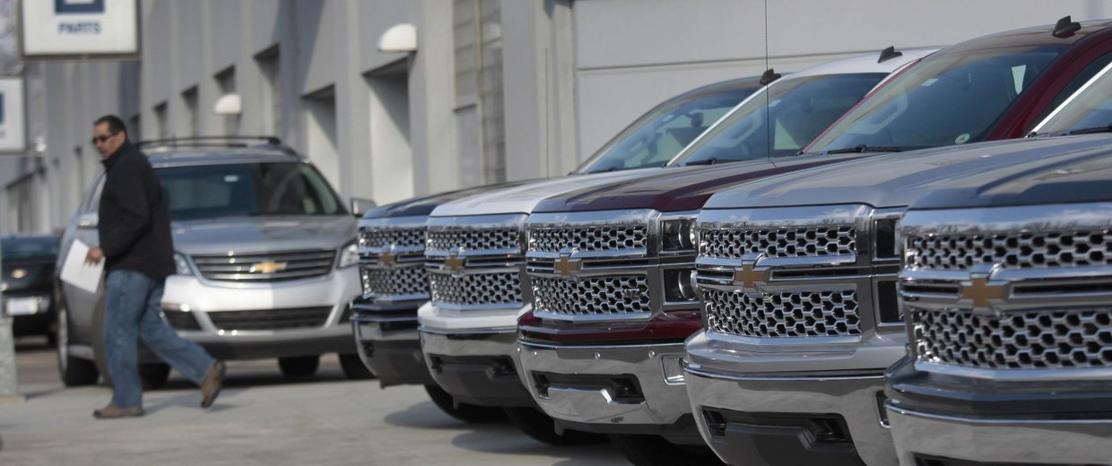 A row of General Motors vehicles at a Chevrolet dealership on Woodward Avenue in Detroit, Michigan