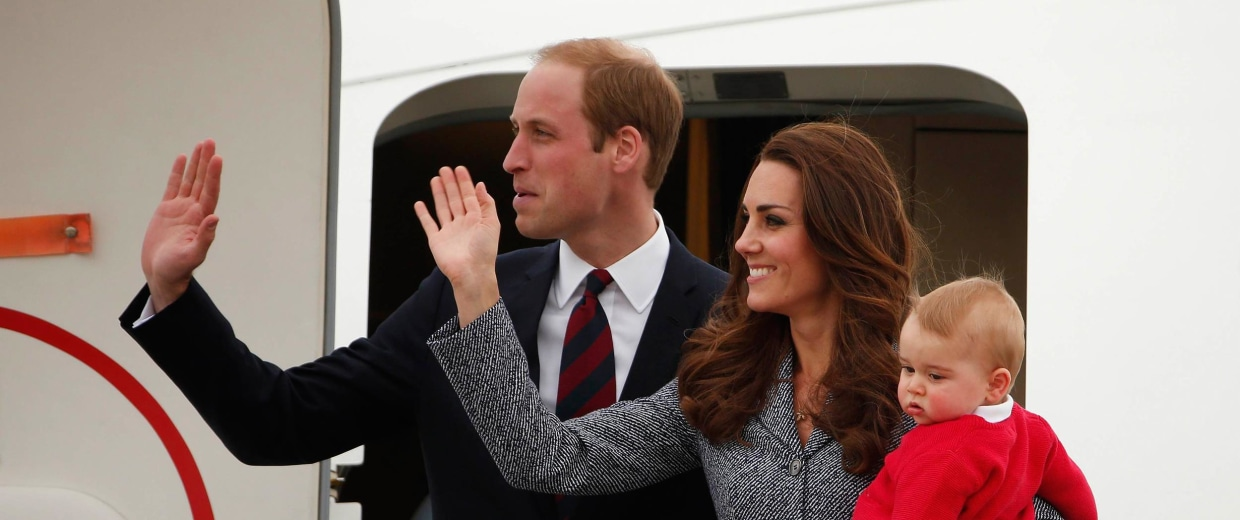Image: Britain's Catherine, the Duchess of Cambridge, waves with her husband Prince William, as she holds her son Prince George before they depart Canberra