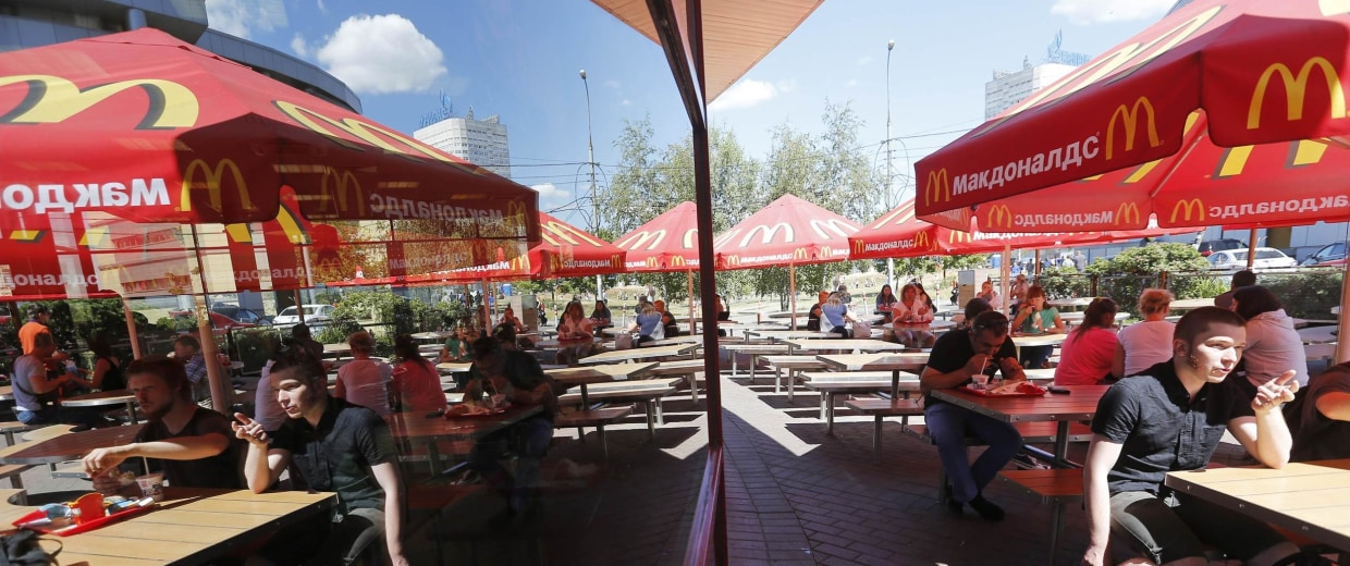 Customers are seen at a McDonald's restaurant on the outskirts of Moscow July 25, 2014.