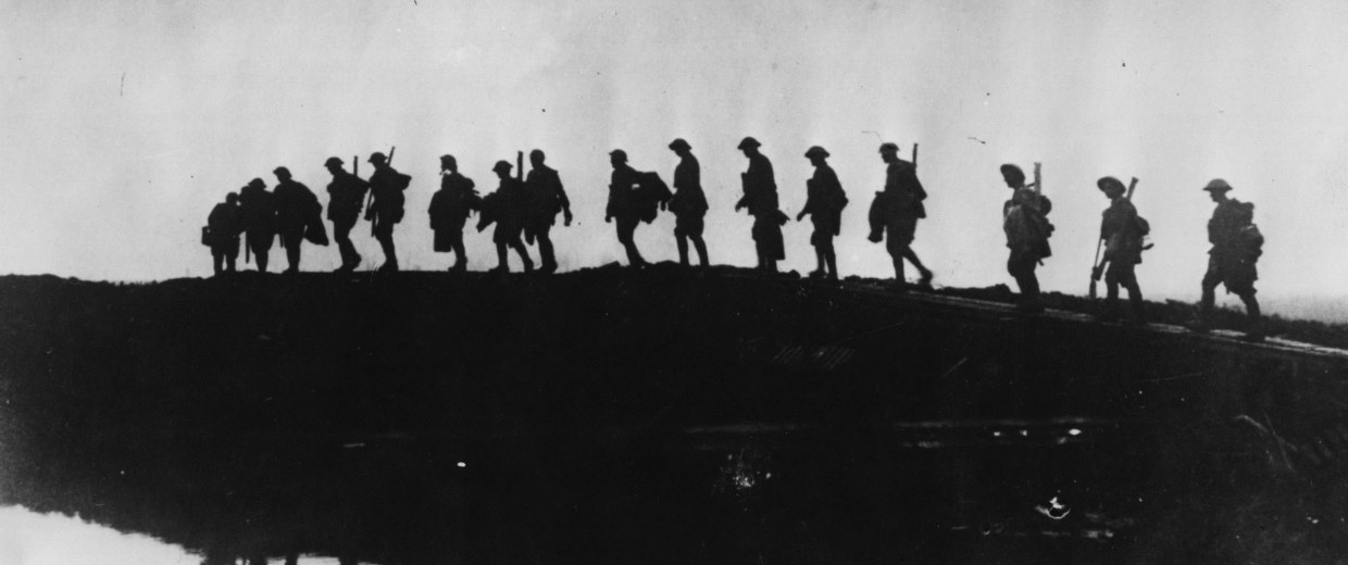 Image: Supporting troops of the 1st Australian Division form a silhouette against the sky as they move toward the front line to relieve their comrades, whose attack the day before won Broodseinde Ridge during World War I.