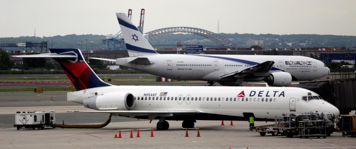 Image: El Al Airlines Flight 28, background, prepares for takeoff from Newark Liberty International Airport en route to Tel Aviv's Ben Gurion Airport