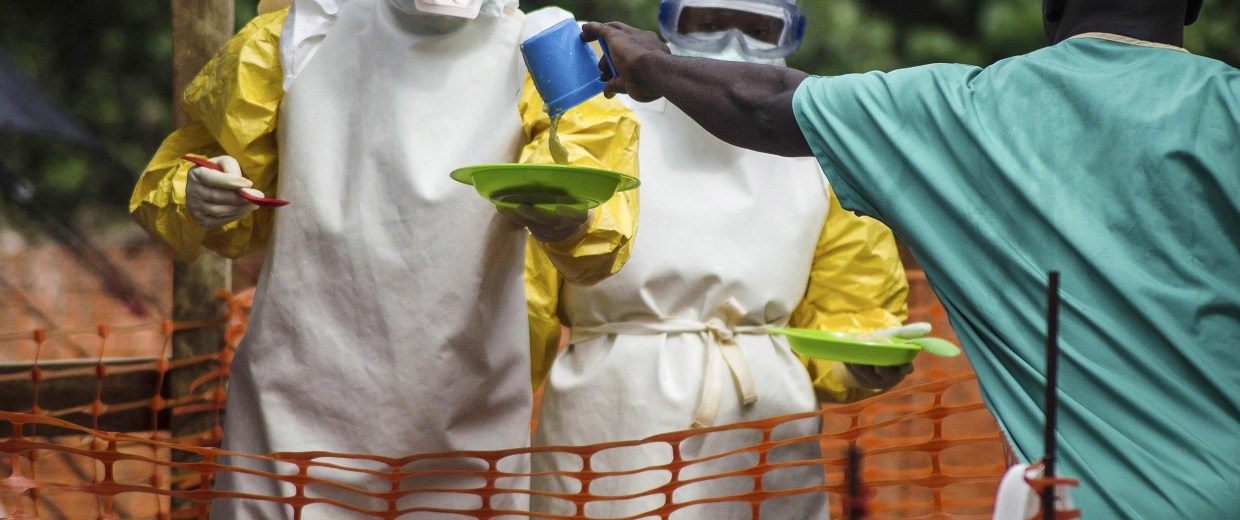 Image: Medical staff working with Medecins sans Frontieres (MSF) prepare to bring food to patients kept in an isolation area at the MSF Ebola treatment center in Kailahun, Sierra Leone