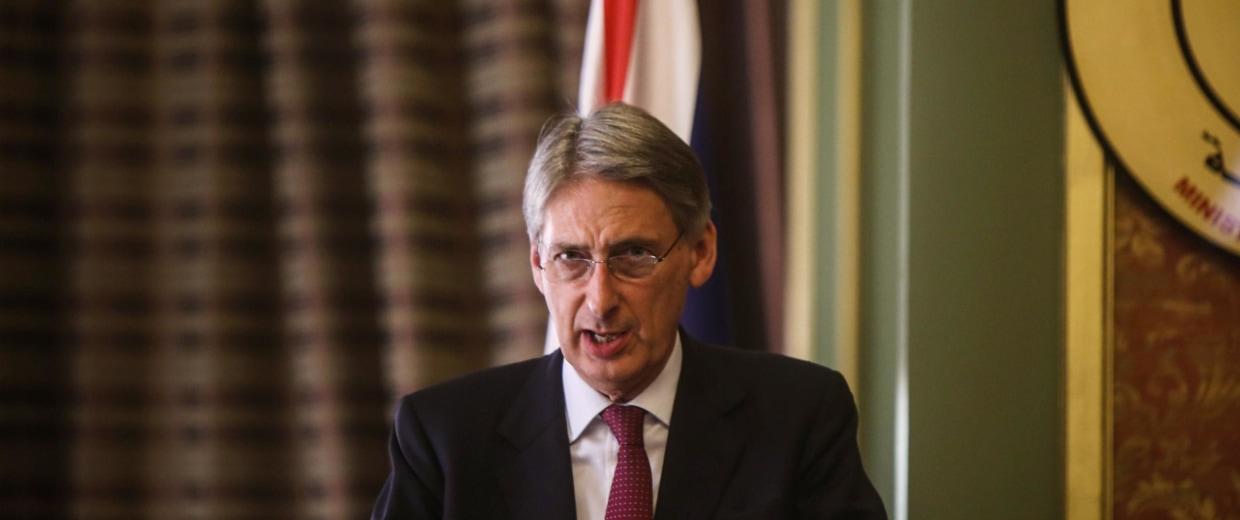 Image: British Foreign Secretary Philip Hammond speaks during a press conference