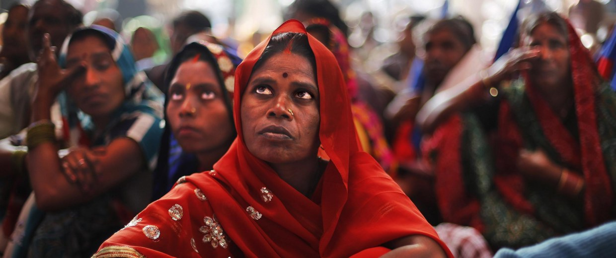 Image: Indian Dalit women, members of the outcast community once known as untouchables, listen to a speaker at a sit in protest on Human Rights Day