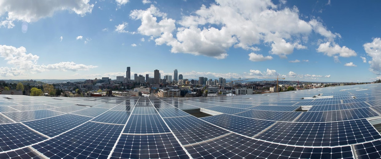 Image: An array of 575 solar panels covers the roof, which slopes 5 degrees to southwest