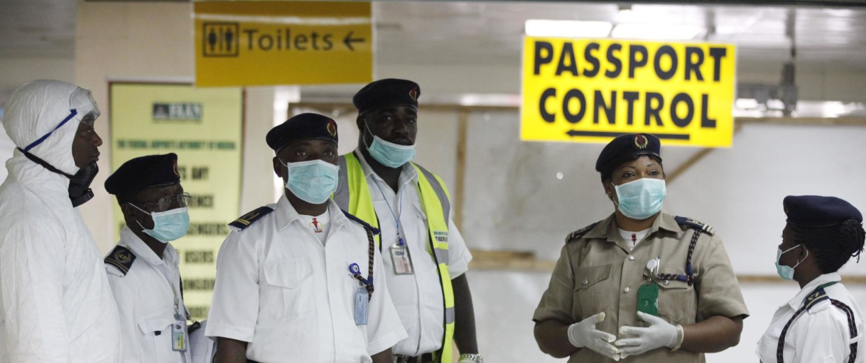 Image: Nigeria health officials wait to screen passengers at the arrival hall of Murtala Muhammed International Airport in Lagos, Nigeria, on Monday, Aug. 4, 2014. Nigerian authorities on Monday confirmed a second case of Ebola in Africa's most populous c