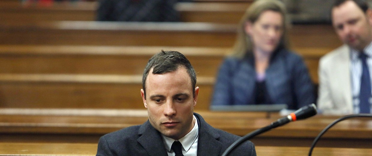Image: South African Paralympic athlete Oscar Pistorius looks on during his ongoing murder trial on July 8.