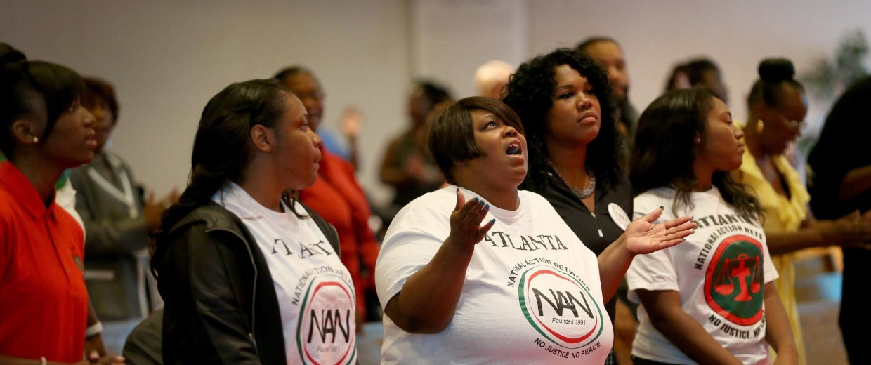 Image: Parishioners at the Greater St. Marks Family Church pray together