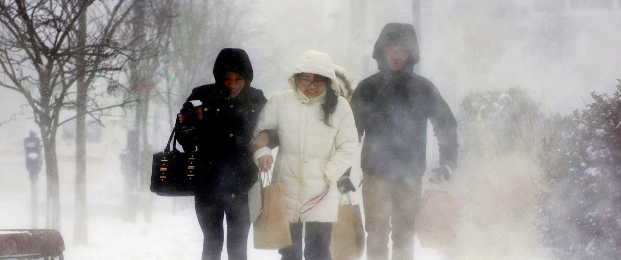 Image: Residents return from a grocery store in Buffalo, N.Y.