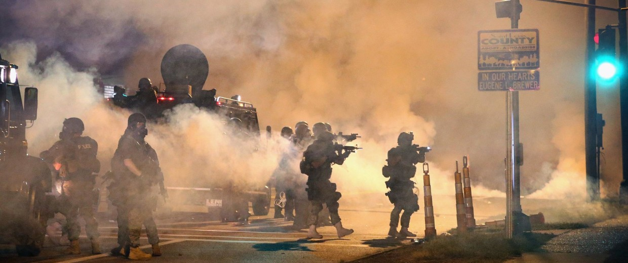Image: Police attempt to control demonstrators protesting the killing of teenager Michael Brown