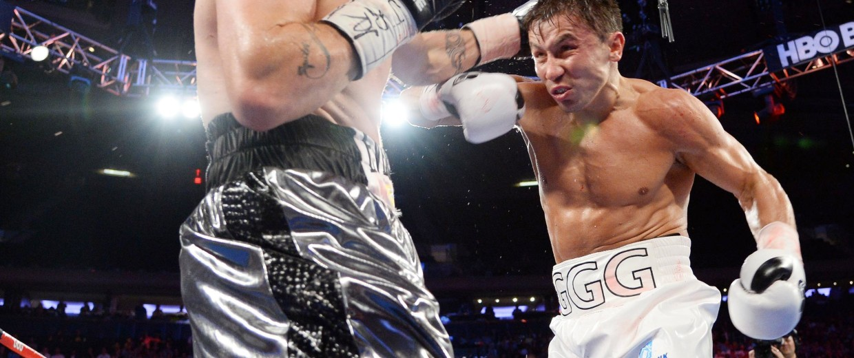 Gennady Golovkin (white gloves) and Daniel Geale (black gloves) box during their middleweight championship bout at Madison Square Garden.