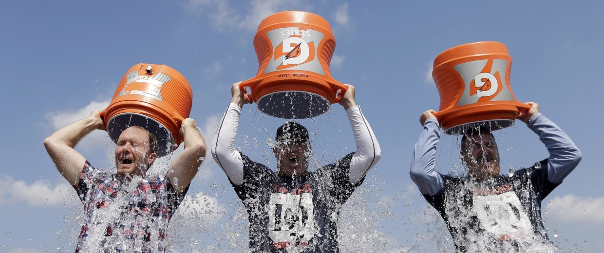 Image: Houston Texans coach Bill O'Brien, Chief Operating Officer Cal McNair, and Houston Chronicle reporter Brian Smith, pour ice cold water over their head after an NFL football training camp practice on Aug. 14