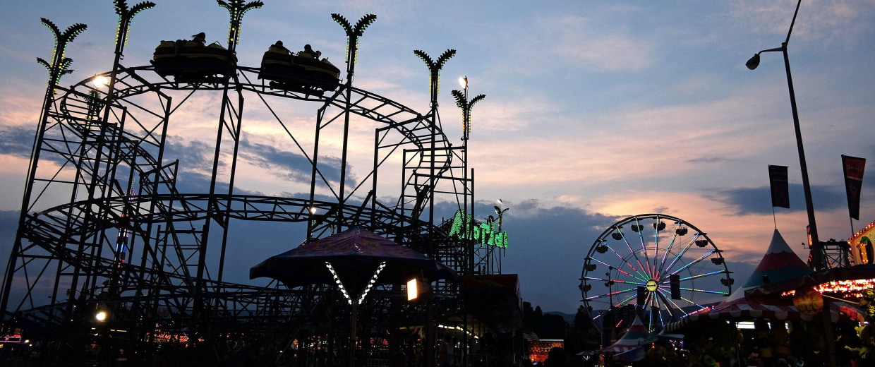 Image: Fair goers ride the Riptide roller coaster at the Salem Fair, in Salem, Va.