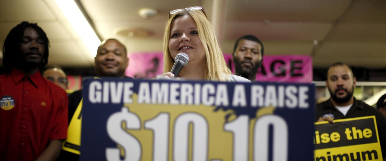 In this photo made Friday, April 25, 2014, Amy Jennewein speaks during a rally in support of raising the minimum wage.