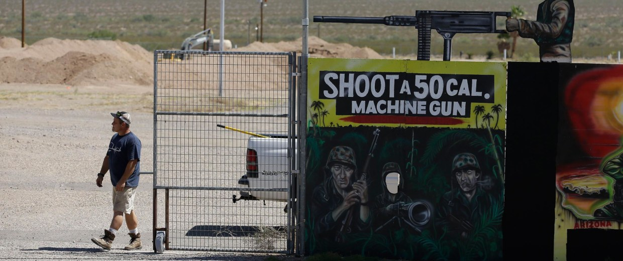 Image: A man closes off an entrance to the Last Stop outdoor shooting range