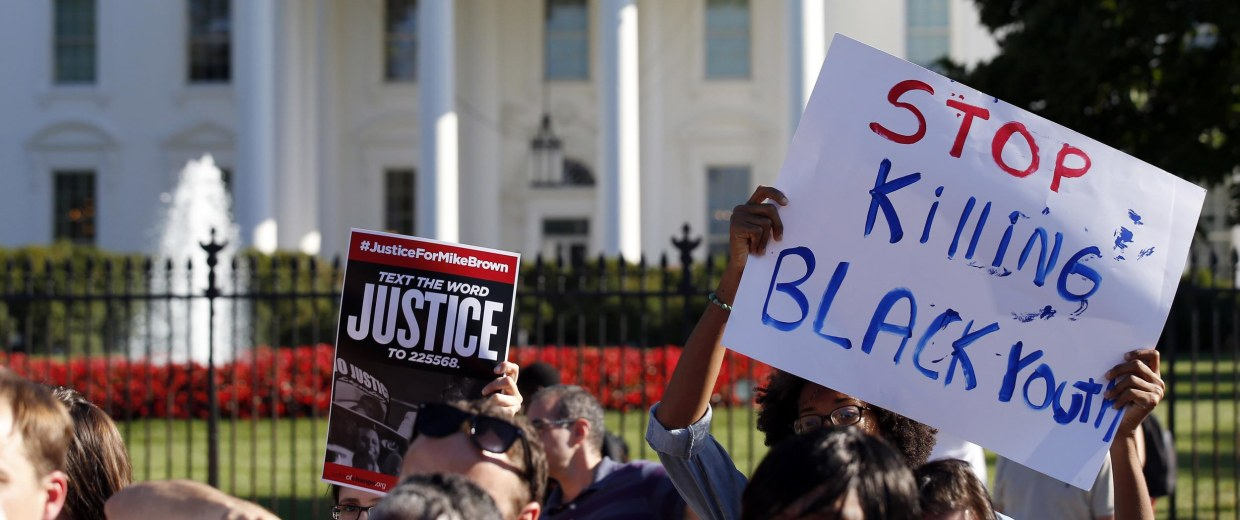 Image: A sign is held during a rally for justice for Michael Brown, and the people of Ferguson, Mo., in front of the White House