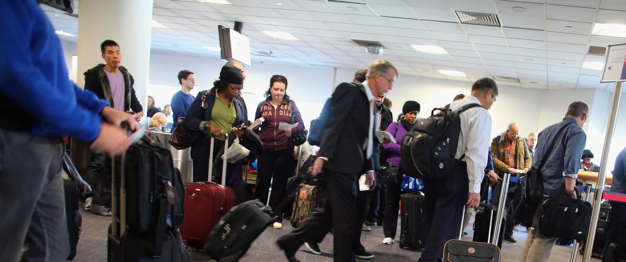 Image: Passengers wait to board their plane at the Delta terminal in LaGuardia Airport