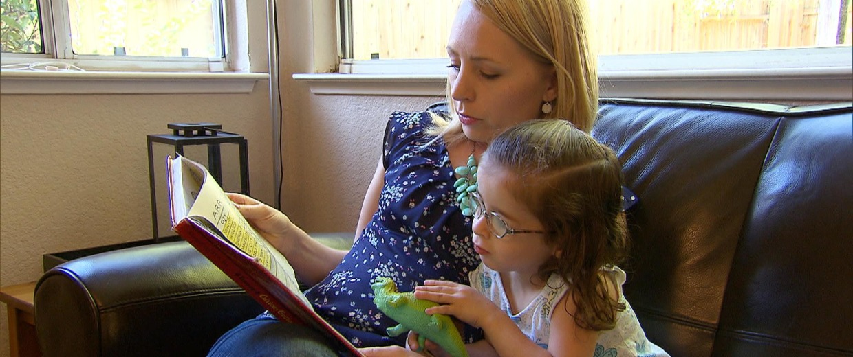 Image: Megan reads a book to her daughter, Isobel, 3, who was diagnosed with autism as a baby