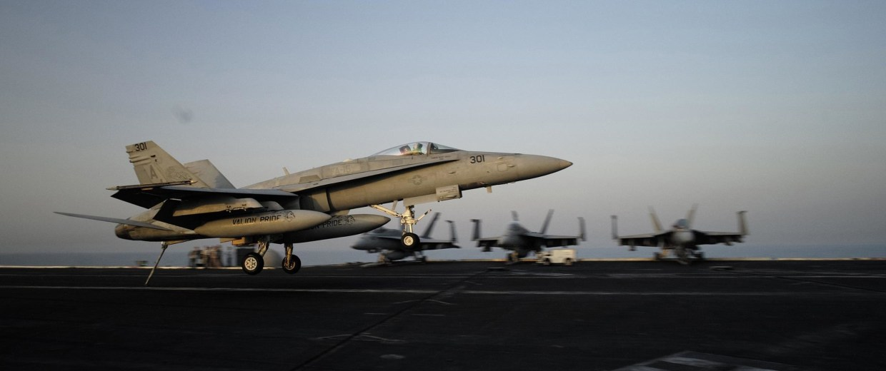 Image: A F/A-18C makes a landing approach onboard the aircraft carrier USS George H.W. Bush in the Gulf