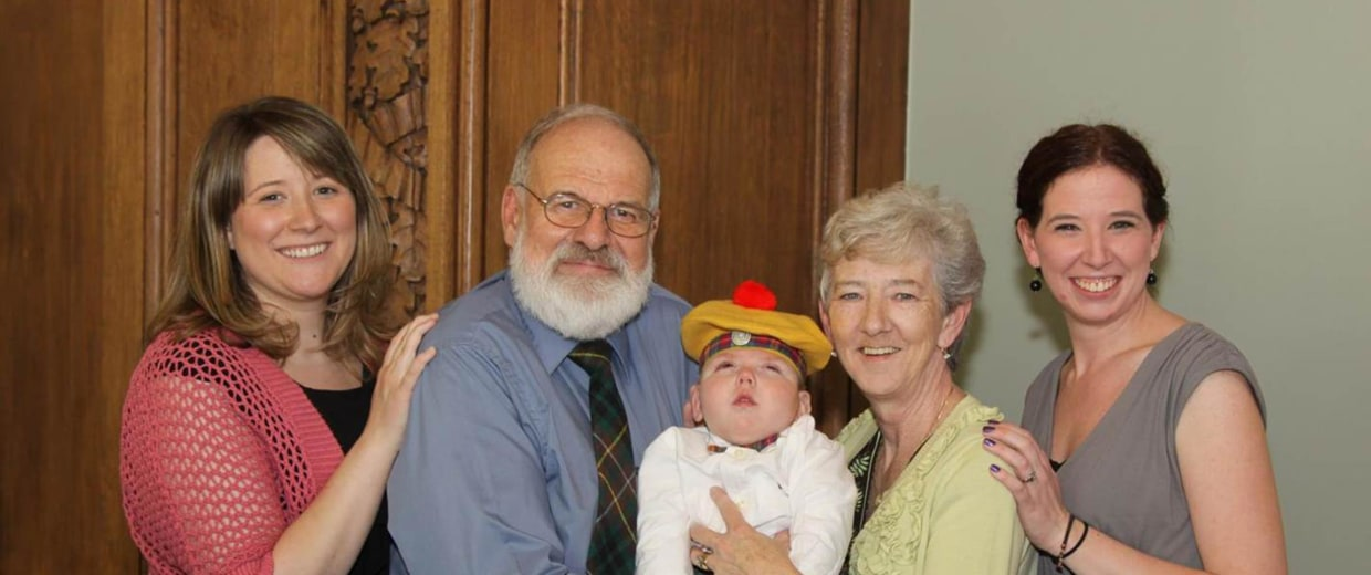 Image: Mark was adopted on his second birthday in 2012. He is shown here in the Buchanan tartan with his parents and sisters Amy Lumsden, left, and Jessica Buchanan.