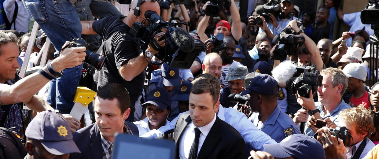Image: Paralympic track star Pistorius leaves after hearing the verdict of his trial at the high court in Pretoria