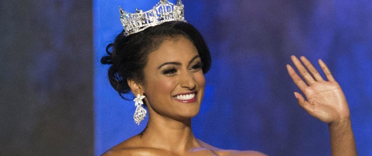Image: Miss America 2014 Nina Davuluri waves as she is introduced ahead of the second preliminary night of the 2015 Miss America Competition in Atlantic City