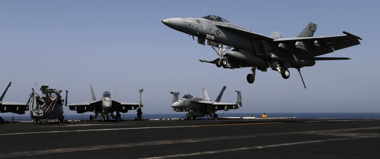 Image: A F/A-18C Hornet of Strike Fighter Squadron (VFA-15) makes landing approach on the flight deck of the aircraft carrier USS George H.W. Bush (CVN 77), in the Gulf
