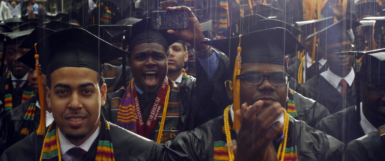 Image: Graduates of the class of 2013 react to their commencement address given by U.S. President Obama during a spring downpour at Morehouse College in Atlanta
