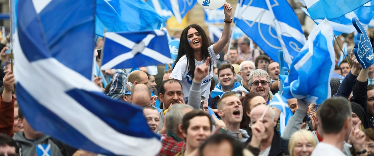 Image: Campaigners wave Scottish flags at a 'Yes' campaign rally in Glasgow on Wednesday