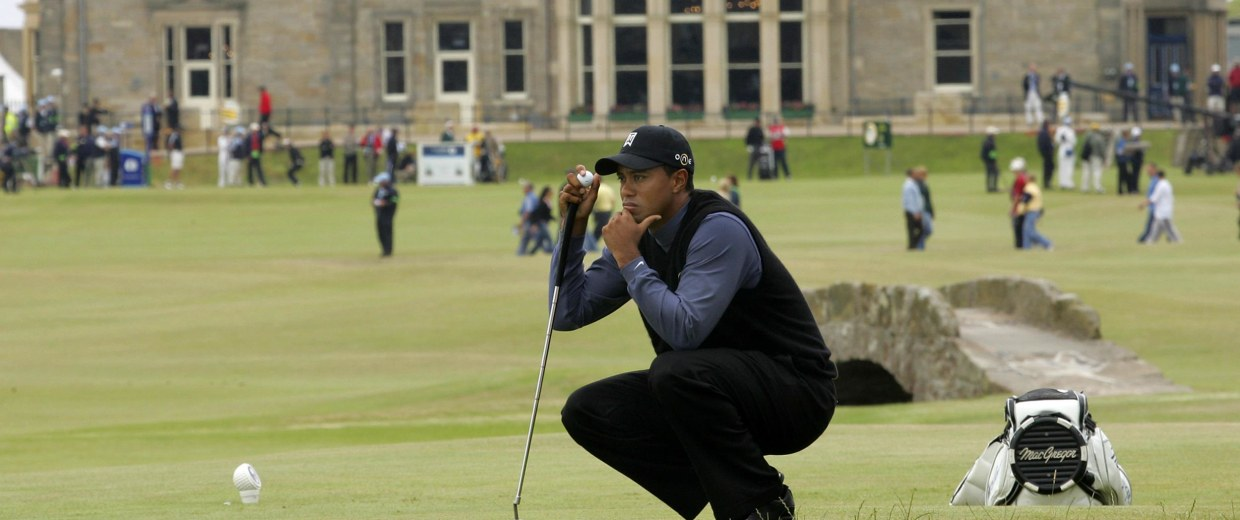 Image:Tiger Woods of the United States pauses on the 17th green during the first round of the British Open golf championship on the Old Course at St. Andrews, Scotland in 2005.