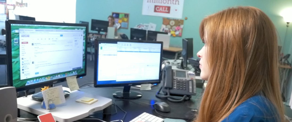 Image: An agent works at a call center for the National Domestic Violence Hotline in Austin, Texas.