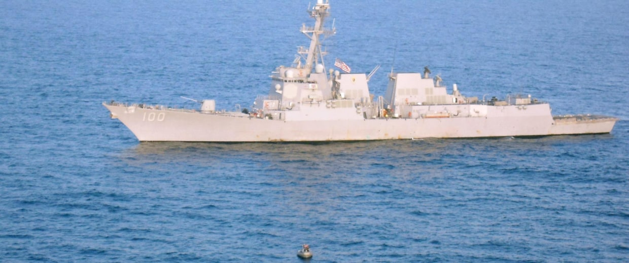 The guided-missile destroyer USS Kidd (DDG 100) responds to a distress call from the master of the Iranian-flagged fishing dhow Al Molai, who claimed he was being held captive by pirates.