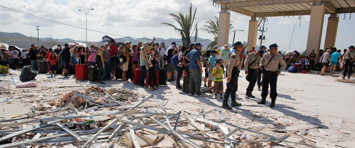 Image: Mexico's newest police force, the Gendarmerie federal police, organize the evacuation of tourists after Hurricane Odile devastated the tourist resort city of San Jose de los Cabos, Mexico