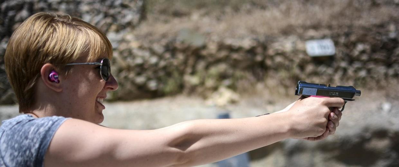 Image: Kasey Hansen fires at a target at a shooting range outside Salt Lake City