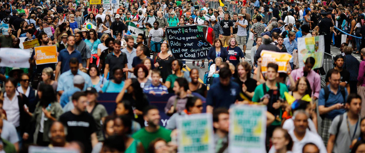 Image: People march during a rally against climate change in New York