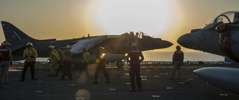 Image: An AV-8B Harrier jet launching from the flight deck of the amphibious assault ship U.S.S. Makin Island during flight operations in the Arabian Gulf