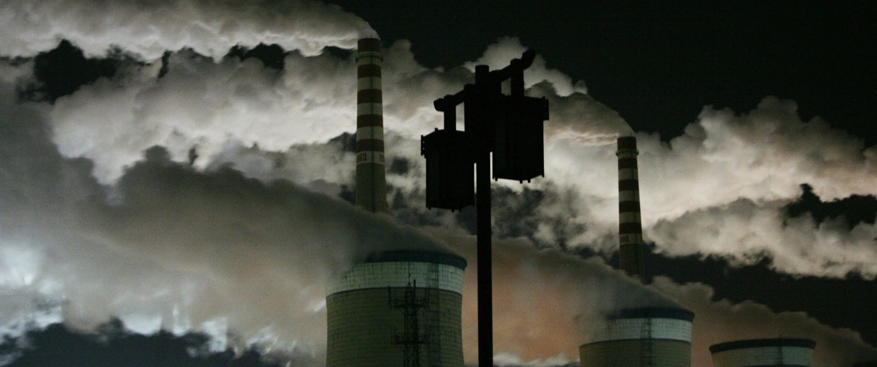 Image: File photo shows a street lamp in front of Datong's second coal-fired power plant at night on the outskirts of Datong, Shanxi province