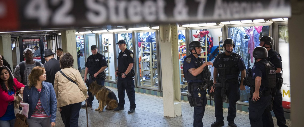 Image: NYPD officers from a Transit Operational Response Canine Heavy Weapons team with a dog patrol in the Times Square subway station in New York