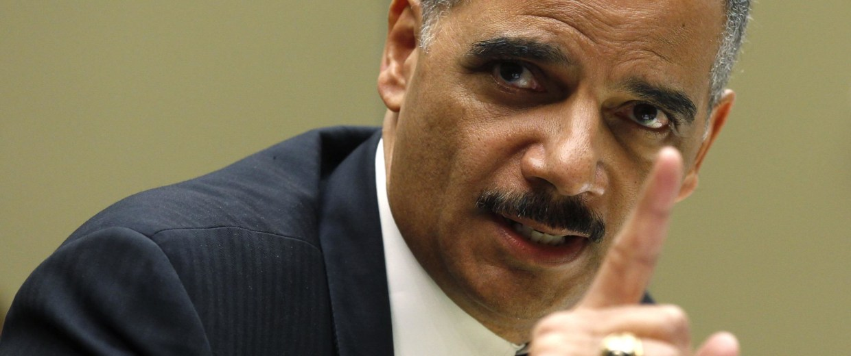Image: U.S. Attorney General Holder testifies before a House Oversight and Government Reform Hearing on Capitol Hill in Washington