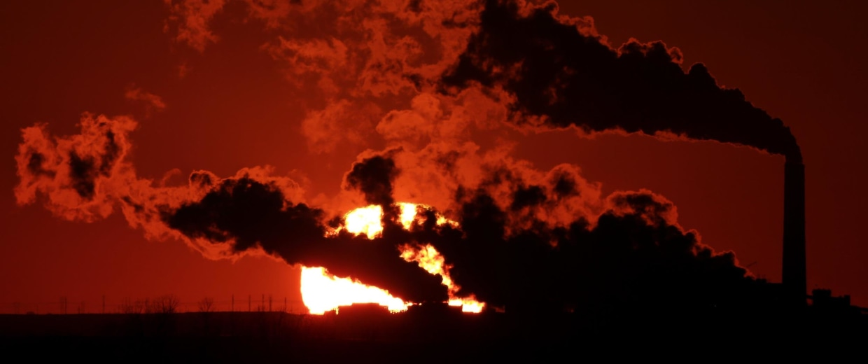 Image: Steam from the Jeffrey Energy Center coal-fired power plant is silhouetted against the setting sun near St. Marys, Kan.