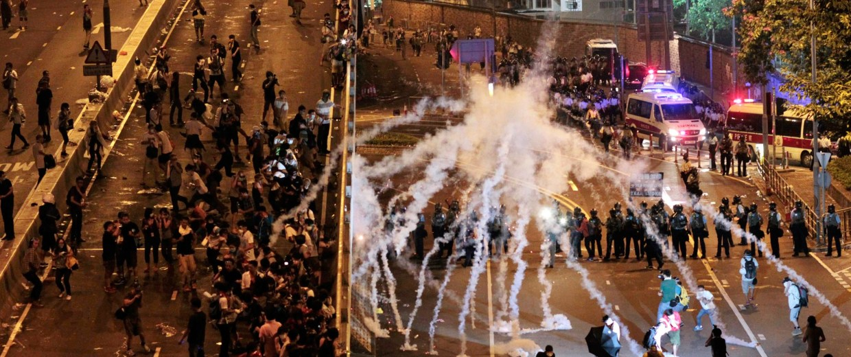 Image: Riot police fire tear gas on student protesters occupying streets surrounding the government headquarters in Hong Kong