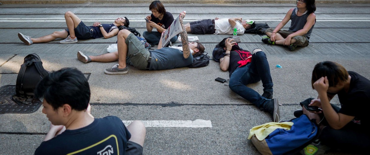 Image: Pro-democracy demonstrators rest during a protest in Hong Kong on September 30