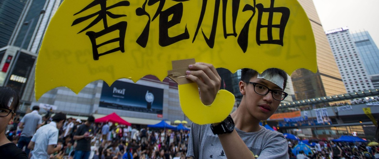 """A boy holds a sign which reads """"Hong Kong push harder"""" in the Admiralty district of Hong Kong on October 2, 2014."""