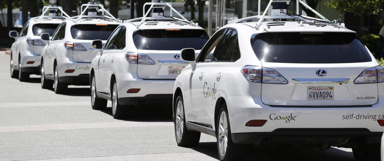 Image: A row of Google self-driving cars outside the Computer History Museum in Mountain View, Calif., on May 14.
