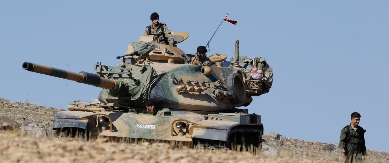 Image: Turkish soldiers sit atop of a tank