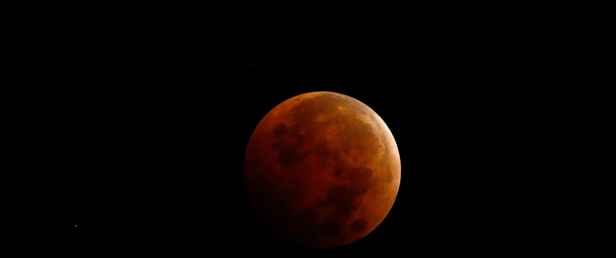 "Image: A total lunar eclipse, also known as a ""blood moon"", is pictured from Encinitas, California"