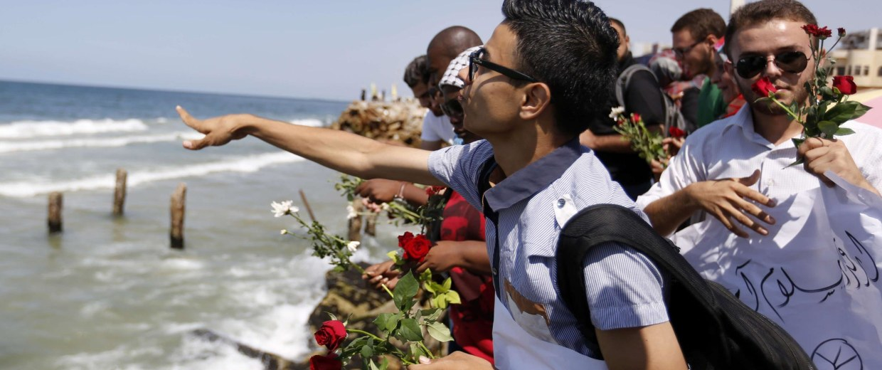 Image: Palestinians throw roses in the Mediterranean sea off the coast of Gaza City