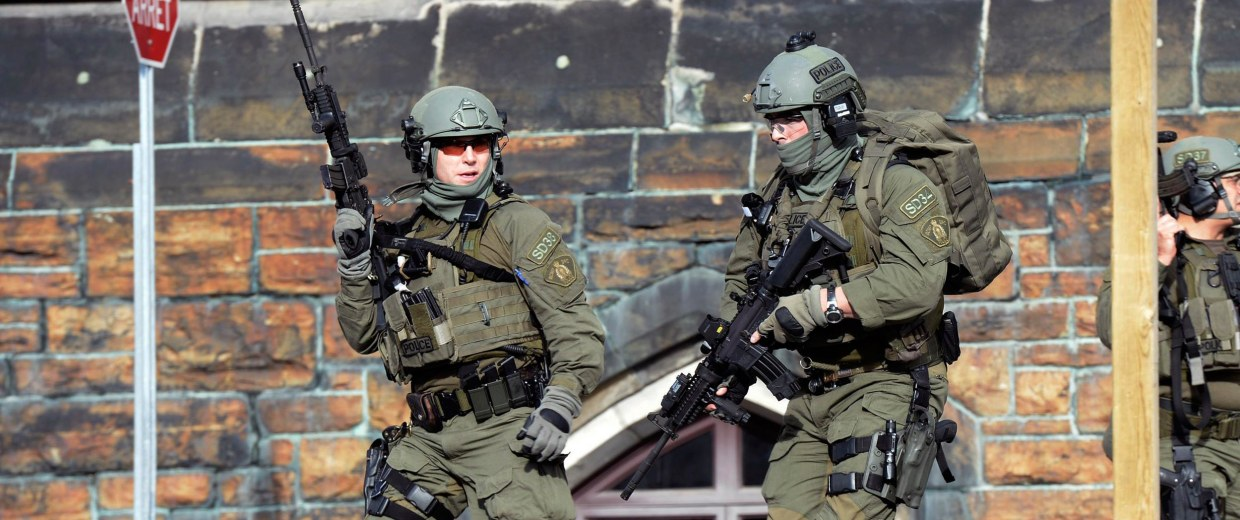 Image: A Royal Canadian Mounted Police intervention team responds to a shooting