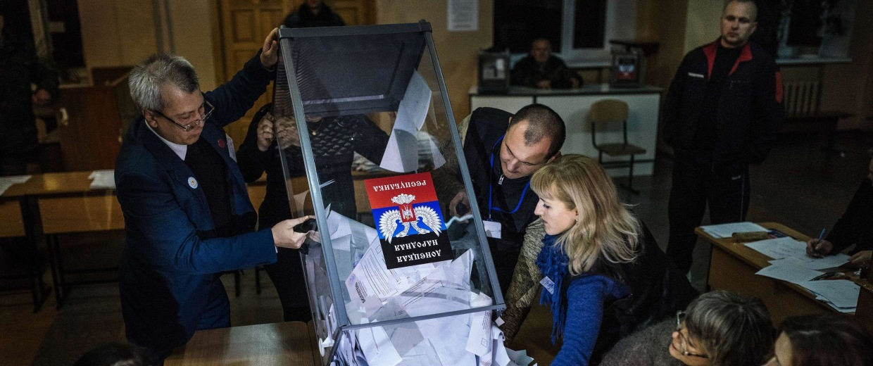 Image: Electoral workers empty a ballot box